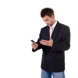 Frowned businessman with cell phone Stock Images