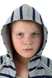 Frowned young boy in gray hood isolated on white Stock Photography