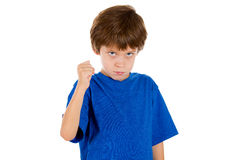 A  frowning angry kid with clenched fist Stock Photography
