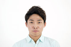 Frowning asian male student Stock Images