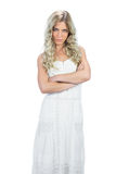 Frowning attractive model in white dress posing Royalty Free Stock Photography