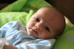 Frowning baby boy. Newborn baby boy making a frowning face Royalty Free Stock Images