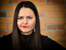 Frowning beautiful young woman Stock Image