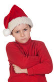 Frowning boy with santa hat Stock Photography