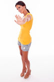 Frowning brunette woman gesturing on white Royalty Free Stock Photo