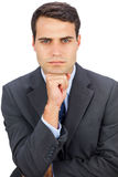 Frowning businessman looking at camera Royalty Free Stock Images