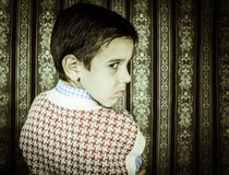 Frowning child vintage clothes. Stock Photos