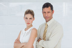 Frowning coworkers posing together Stock Images
