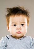 Frowning eye baby Stock Images