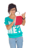 Frowning female student looking in the book Stock Images