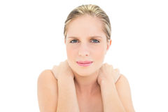 Frowning fresh blonde woman suffering from sore neck Stock Photography