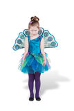 Frowning girl in carnival costume stands Stock Images