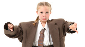 Frowning Girl in Suit. Adorable 6 year old blond girl in over-sized baggy suit with thumbs down and frown over white background Stock Photo