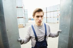 Frowning worker accepting cargo royalty free stock photo