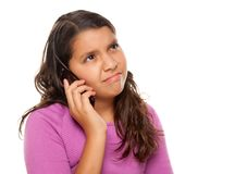 Frowning Hispanic Girl On Cell Phone Royalty Free Stock Images