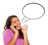 Frowning Hispanic Teen Aged Girl on Phone Royalty Free Stock Photography