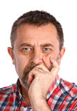 Frowning man. Portrait of an middle age man with face closed by hand. Isolated on white stock images
