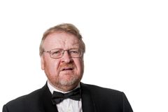 Frowning middle aged man in tuxedo on white Stock Photo