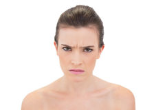 Frowning natural brown haired model looking at camera Royalty Free Stock Photo