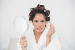 Frowning natural brunette holding tweezers Royalty Free Stock Photography