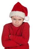 Frowning pojke med den santa hatten Royaltyfri Foto