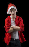 Frowning teen in Santa hat isolated on black backg Royalty Free Stock Photo