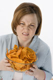 Frowning Woman With Bowl Of Nachos Royalty Free Stock Photography