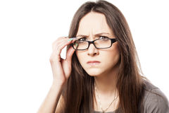 Frowning woman. With glasses on white background royalty free stock images
