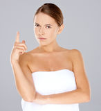 Frowning woman pointing her finger Royalty Free Stock Images