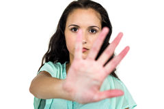 Frowning woman putting hand on camera. On white screen Stock Image