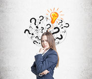 Frowning woman, questions and light bulb Stock Photos