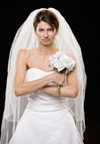 Frowning young bride in wedding dress and veil Stock Photo
