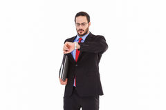 Frowning young businessman checking time Royalty Free Stock Image