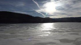 Frozen Alpine Lake Landscape. An alien like landscape of a frozen lake stock video footage