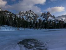 Frozen alpine lake and mountain landscape at dusk Royalty Free Stock Photos