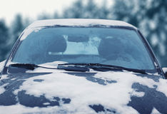 Frozen сar covered snow in winter, view windshield hood Royalty Free Stock Photography
