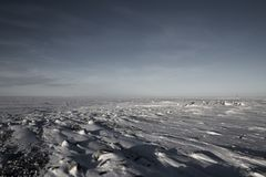 Frozen arctic landscape with snow on the ground Stock Photos