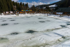 Frozen artificial lake in a ski-resort. In winter period Royalty Free Stock Image