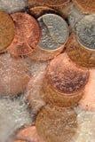 Frozen Assets. British money frozen in ice stock image