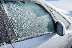 Frozen automotive glass covered with ice stock image