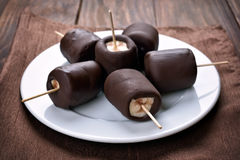 Frozen banana covered with chocolate Royalty Free Stock Images