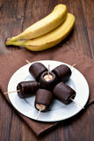 Frozen banana covered with chocolate Royalty Free Stock Photography