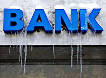 Frozen bank sign. Frozen blue 3d bank sign with ice pendants royalty free stock photo