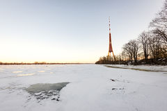 Frozen beach in cold winters day with TV tower in background Royalty Free Stock Photo