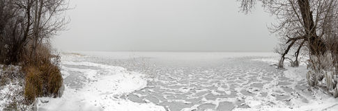 Frozen beach with ice and snow Stock Photos