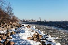 Frozen beach near shipyard and sea port Royalty Free Stock Photography