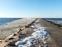 Frozen beach near shipyard and sea port Stock Photo