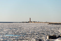 Frozen beach near shipyard and sea port Royalty Free Stock Photos