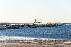 Frozen beach near shipyard and sea port Royalty Free Stock Image