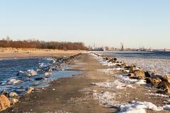 Frozen beach near shipyard and sea port Stock Photography